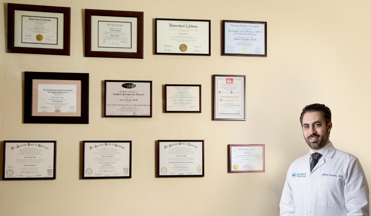 Dr. Eradat wall of credentials accolades